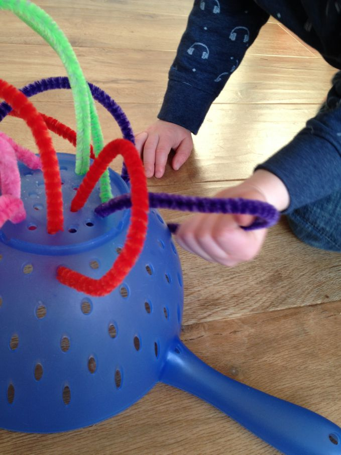 Montessori at home – Pipe Cleaners and Colander