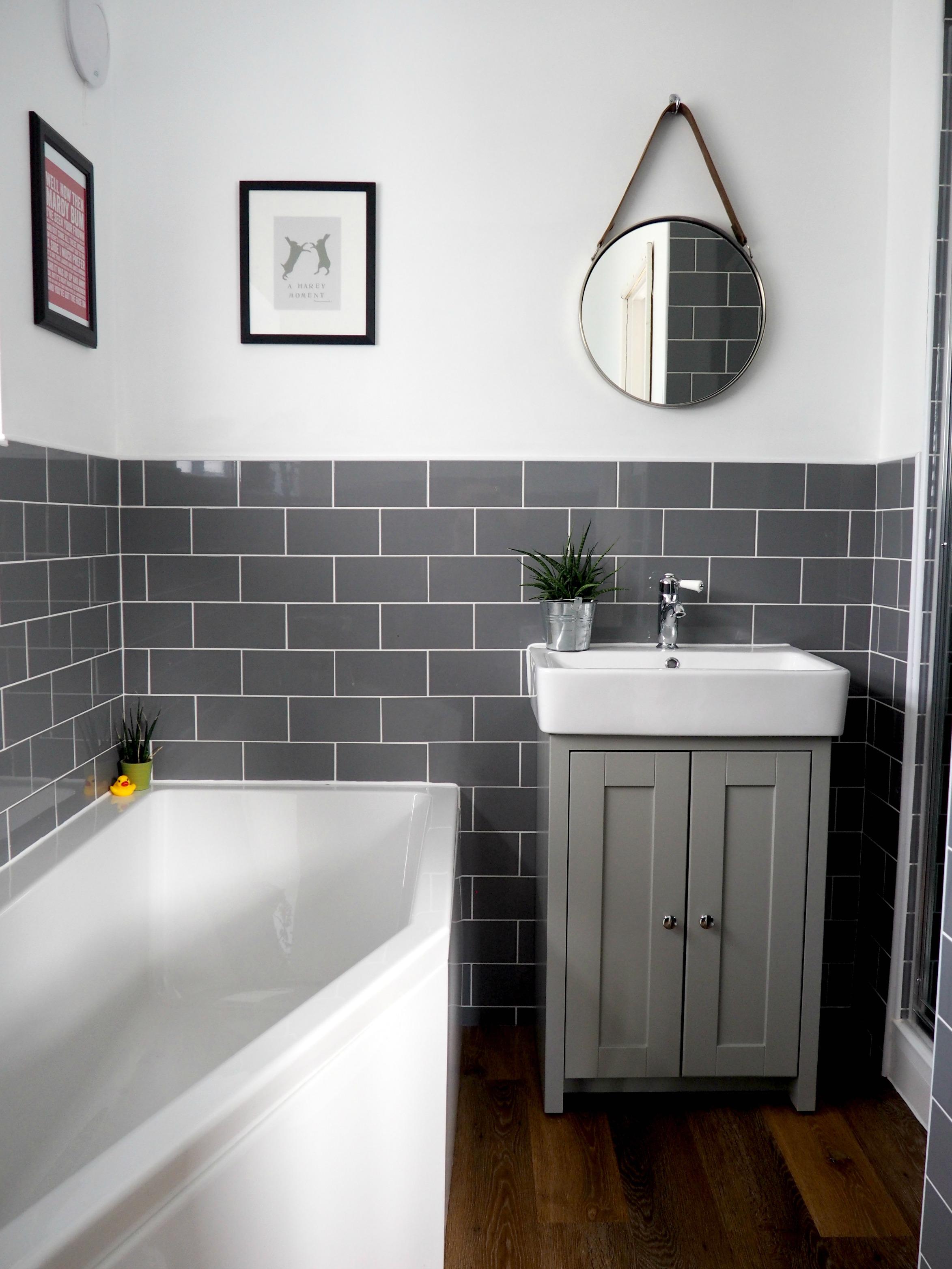 bathroom with grey subway tiles